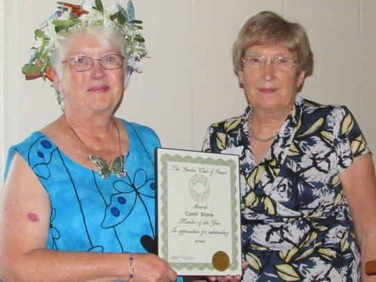 Carol Stone, left, receives the Member of the Year