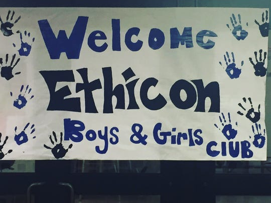The participants of the Boys & Girls Club – Cooke Avenue Unit in Carteret welcome Ethicon volunteers with open arms.