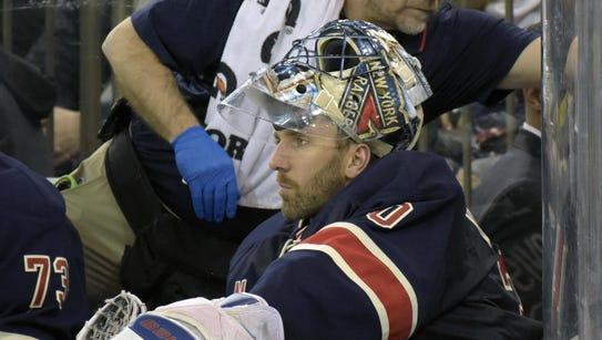 New York Rangers goaltender Henrik Lundqvist sits on