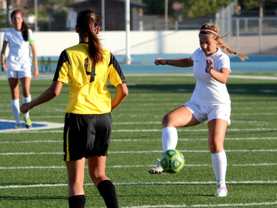 Carlsbad's Madison Austin dribbles the ball in the