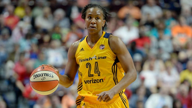 Indiana's Tamika Catchings scored 23 points to help lead the Fever past the Stars on Friday night in San Antonio.