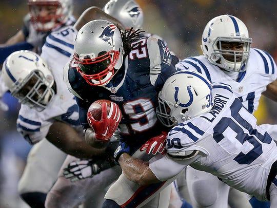 Patriots running back LeGarrett Blount bounces off