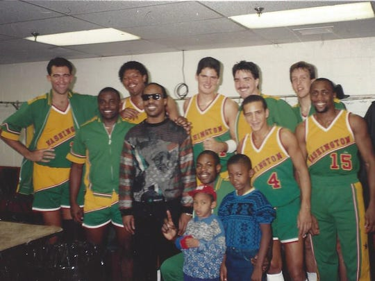 Carl Chrabascz (far left) with his Washington Generals teammates and Stevie Wonder (center).
