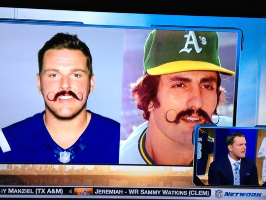 Who wears it better: Pat McAfee or Rollie Fingers?
