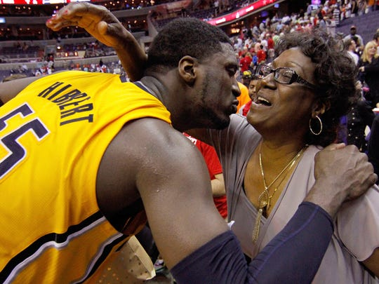 Indiana Pacers center Roy Hibbert (55) kisses his mother Patricia Hibbert after Game 4 of an Eastern Conference semifinal NBA basketball playoff game in Washington, Sunday, May 11, 2014. The Pacers won 95-92.
