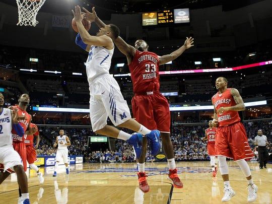 Memphis guard Michael Dixon, Jr. (11) is fouled by Southeast Missouri forward Tyler Stone (33).