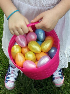 The prize for hop droppers Sunday was a colorful basket of plastic eggs filled with goodies.