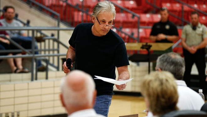 Reeds Spring resident Rick Stebbins delivers a petition, which demanded school district superintendent Michael Mason resign, to school board members during a public meeting of the Reeds Spring School District School Board held at Reeds Spring High School in Reeds Spring, Mo. on April 19, 2017. The meeting drew increased attendance due to recent sexual assault allegations levied against superintendent Michael Mason.