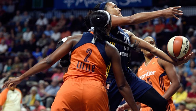 Indiana Fever's Marissa Coleman splits the defense of Connecticut Sun's Camille Little (2) and Alyssa Thomas during the first half of a WNBA basketball game Tuesday, Sept. 13, 2016, in Uncasville, Conn. (Sean D. Elliot/The Day via AP)