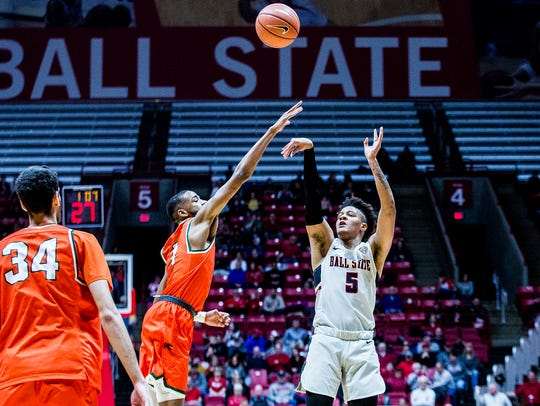 Ball State's Ishmael El-Amin shoots a three past Florida
