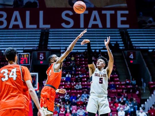 Ball State's Ishmael El-Amin shoots a three past Florida