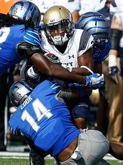 University of Memphis defense brings down Navy running back Darryl Bonner (middle) during first quarter action Liberty Bowl Memorial Stadium in Memphis, Tenn., Saturday, October 14, 2017.