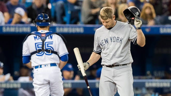 New York Yankees' Chase Headley reacts after striking out against the Toronto Blue Jays during the first inning of a baseball game in Toronto, Friday, Sept. 23, 2016.