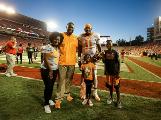 Tennessee coach Larry Scott and his family with quarterback Joshua Dobbs during the game against Georgia at Sanford Stadium.