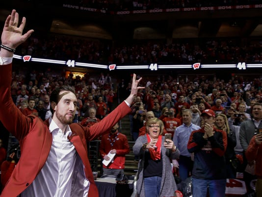 Charolette Hornets' Frank Kaminsky, a former Wisconsin player, walks onto the court before an NCAA college basketball game between Wisconsin and Purdue on Thursday, Feb. 15, 2018, in Madison, Wis. Kaminsky's uniform number was retired during half time at the game. (AP Photo/Andy Manis)