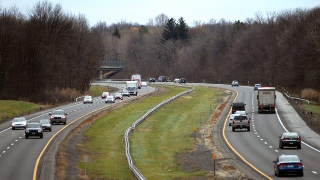 Vehicles make their way on the New York State Thruway.