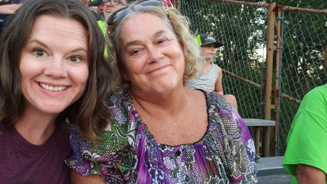 This September 2019 photo provided by Sara Knotts shows Knotts, left, and her mother, Anne Ashcraft, at a demolition derby, in Winnabow, N.C. Knotts, a North Carolina elections director, had to ask members of her board to reject her mother's absentee ballot because she died several weeks before the general election.