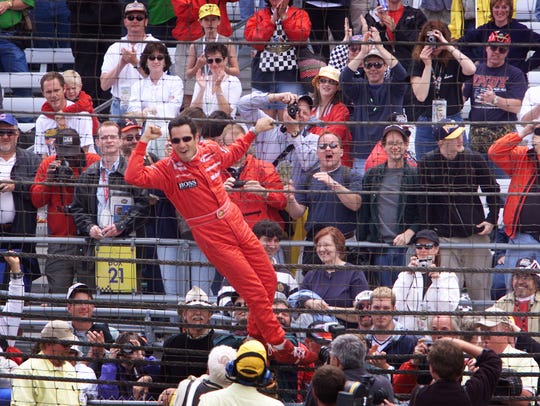 Helio Castroneves revels with fans after winning the Indy 500 as a rookie in 2001.