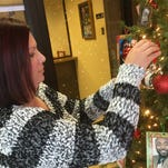 China Telano hangs a Christmas ornament honoring her son, Michael Woods, who was killed in a drunk driving accident in 2012.