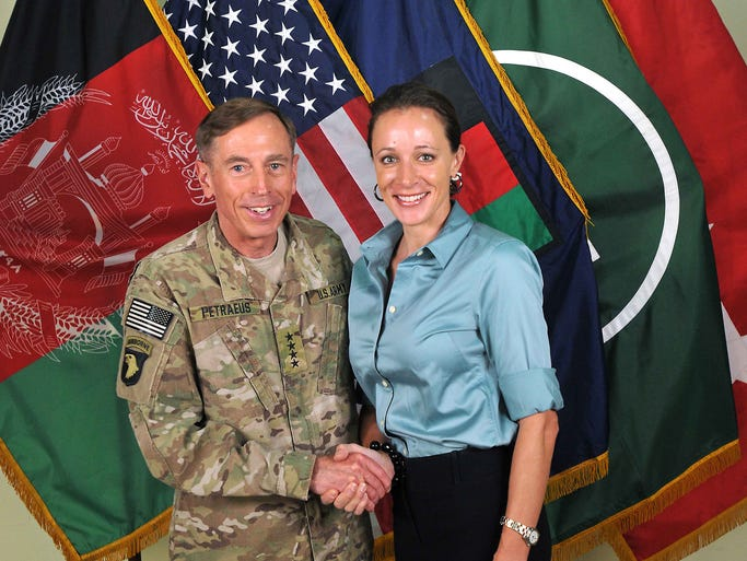 U.S. Army Gen. David Petraeus shakes hands with his