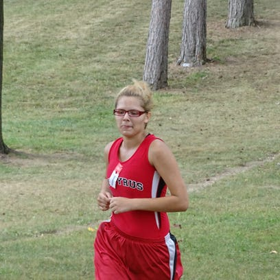 Bucyrus' McKayla Hedrick runs down the final stretch