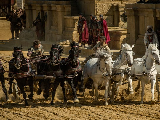 Messala (left, Toby Kebbell) races adopted brother Judah Ben-Hur (Jack Huston) with life and honor at stake in 'Ben-Hur.'