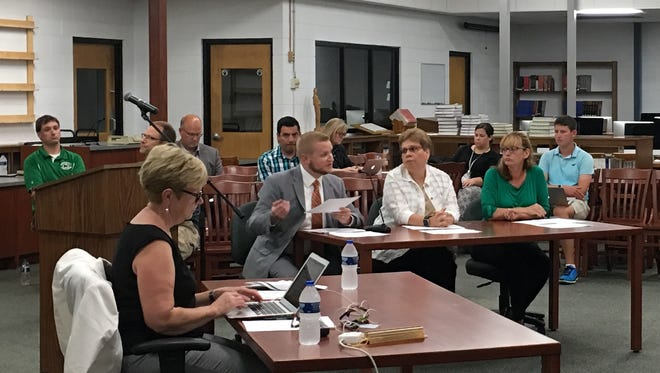 The Greendale Panther Community Facility Advisory Team are recommending that the school board put a $33.8 million referendum on the November ballot to finance school improvement. The team are (from left) Thor Misko, Noelle Yanish and Kristin Settle. Mary Ann Jacobsen, school board secretary, is in typing in the left foreground