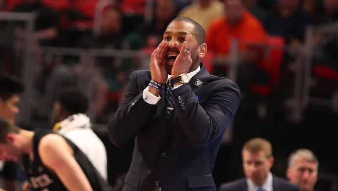 Butler head coach LaVall Jordan shouts plays from court side as his team takes on Arkansas in the first round of the 2018 NCAA Tournament at Little Caesars Arena in Detroit, Friday March 16, 2018.