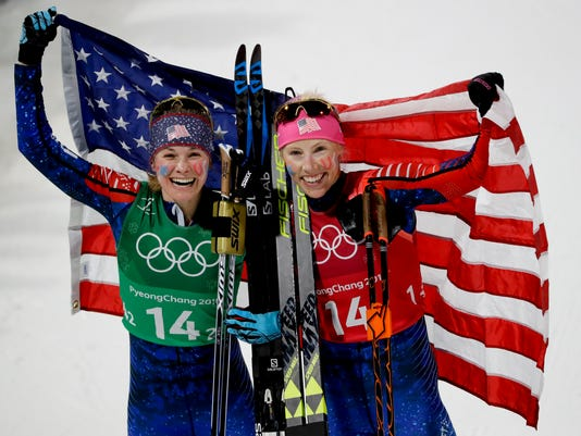 United States' Jessica Diggins, left, and Kikkan Randall celebrate after winning the gold medal in the women's team sprint freestyle cross-country skiing final at the 2018 Winter Olympics in Pyeongchang, South Korea, Wednesday, Feb. 21, 2018. (AP Photo/Kirsty Wigglesworth)