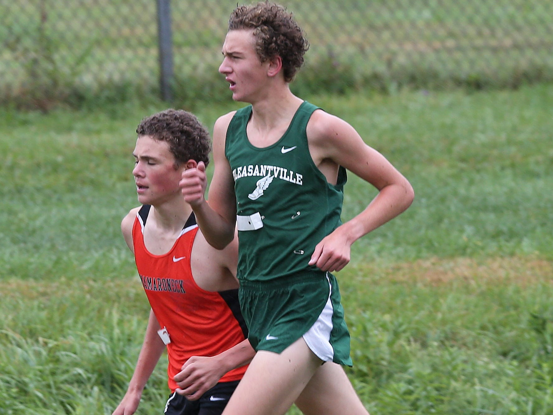 Pleasantville's Drew Dorflinger and Mamaroneck's Samuel Morton run side by side during the boys D 1 varsity race during the 38th annual Brewster Bear Classic Cross Country Invitational at Brewster High School Oct. 3, 2015. Dorflinger won the race with Morton finishing second.