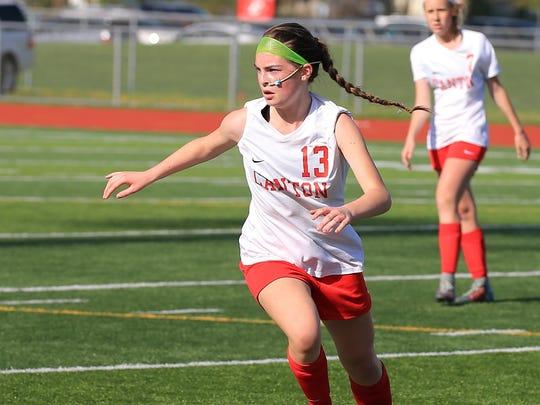 Running full tilt during a Canton JV girls soccer game is Makenzie Carpenter.