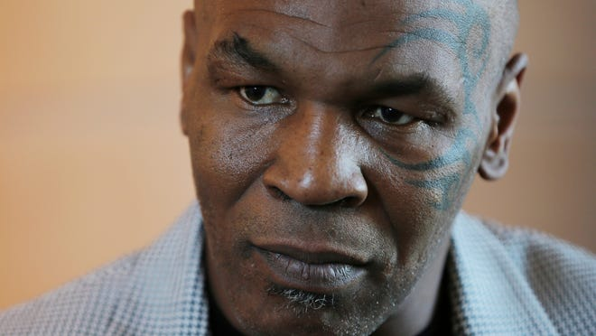 FILE - In this May 4, 2017 file photo, Mike Tyson gives an interview to The Associated Press, in Dubai, United Arab Emirates. Chilean authorities said Thursday, Nov. 9, 2017, that the former heavyweight champion has been denied entry to the country and is being sent back to the U.S. (AP Photo/Kamran Jebreili, File)