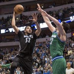 Minnesota Timberwolves center Karl-Anthony Towns (32) shoots over Dallas Mavericks center Zaza Pachulia (27) during the second half Wednesday at the American Airlines Center in Dallas, Texas.