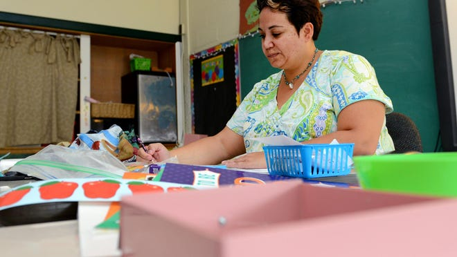 Stacy Buckner, special education teacher, prepares her classroom at Sheridan Road Elementary in Lansing. Buckner is in her second year at Sheridan, but 15th in the district.