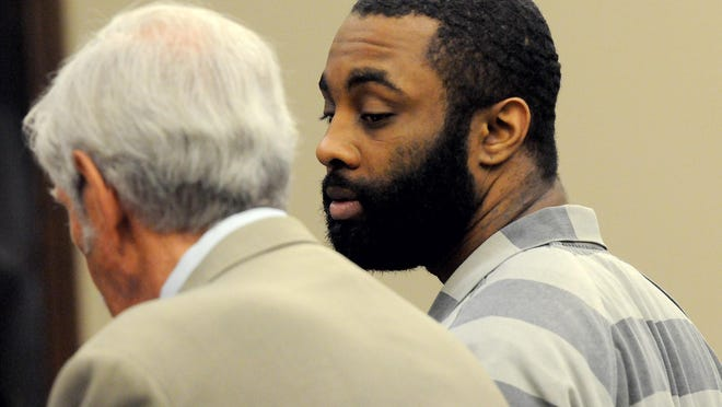 Jonathan Purnell, is seen in this 2015 LSJ file photo speaking with his attorney, Stuart Allen, before pleading guilty for his role in a sex-trafficking ring.