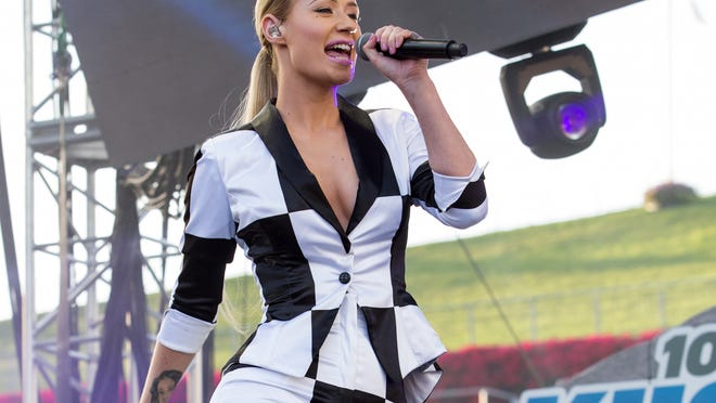 FILE - This May 10, 2014 file photo shows Iggy Azalea performing on stage at 102.7 KIIS FM's Wango Tango at the StubHub Center, in Carson, Calif. MTV said Thursday, July 24, 2014 that the singer featured in the summer hits ìFancyî and ìProblemî will provide a running commentary on fashion during the annual awards show, scheduled for Aug. 24. The following night, Azalea will channel her inner Joan Rivers for an MTV fashion recap show under the ìHouse of Styleî banner. (Photo by Paul A. Hebert/Invision/AP, File) ORG XMIT: NYET406