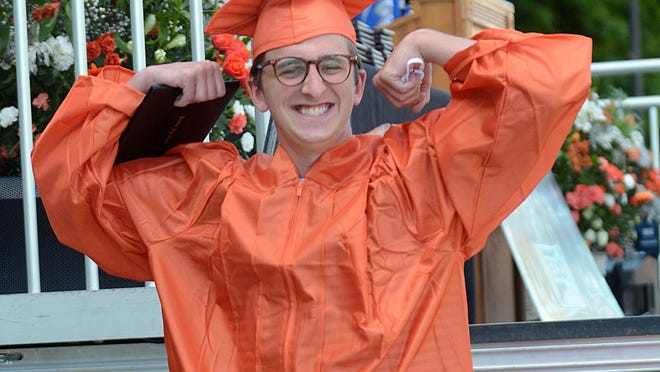 Plainfield High School graduate Connor Abram celebrates after getting his diploma Friday in a parking lot at the school.  See videos and more photos at NorwichBulletin.com