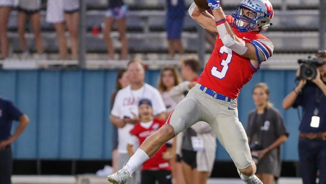 Westlake cornerback Lucas Mireur makes an interception during a win over Akins last season. He returns as part of a loaded secondary for the Chaps.