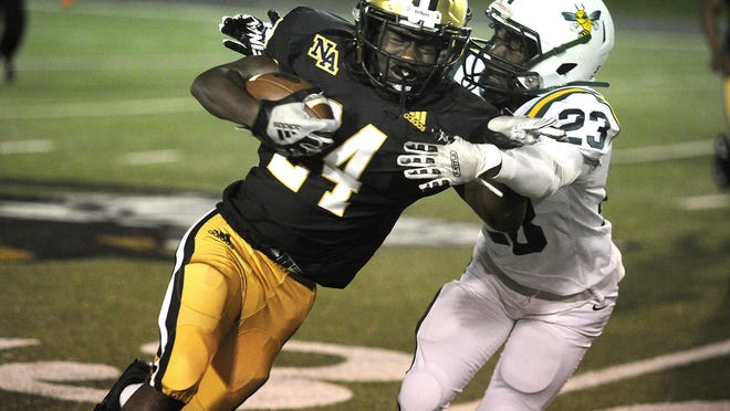 Taylon Washington of North Augusta, left, tries to break the tackle of Aiken's Iterrius Johnson at the high school football game between North Augusta and Aiken on October. 23, 2020 in Augusta, Ga.