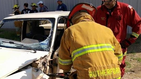 Volunteer firefighters train with the Jaws of Life.
