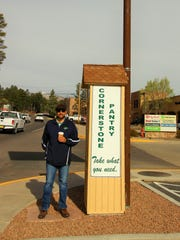 Cornerstone Pantry co-owner Steve Gomez stands next to the restaurant's new community pantry.