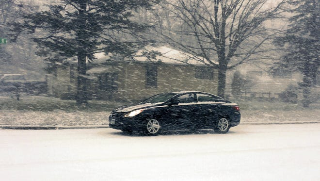 Wind-driven snow made for slippery roads Thursday morning.