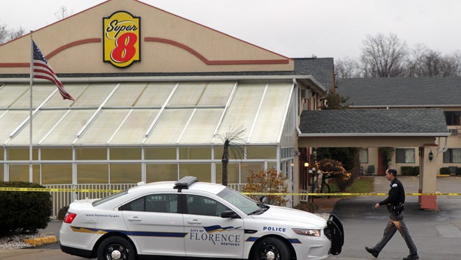 The Florence Super 8 Motel where a man was shot and killed Tuesday and a police officer was injured is still cordoned off Wednesday as the investigation continues.