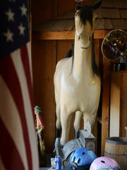"""""""Charlie, the full-size 100-year-old papier-mache horse with a real mane and tail, will remain part of the store,"""" said Michelle Jackson, who has sold the business to her son, Pat. Charlie stands in the front window of Haegle's Western Wear and Tack."""