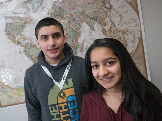 Ameen Abou-Rjaily, left, is the geography bee champion at Meads Mill Middle School. Smrithi Kattethota is the runner-up.