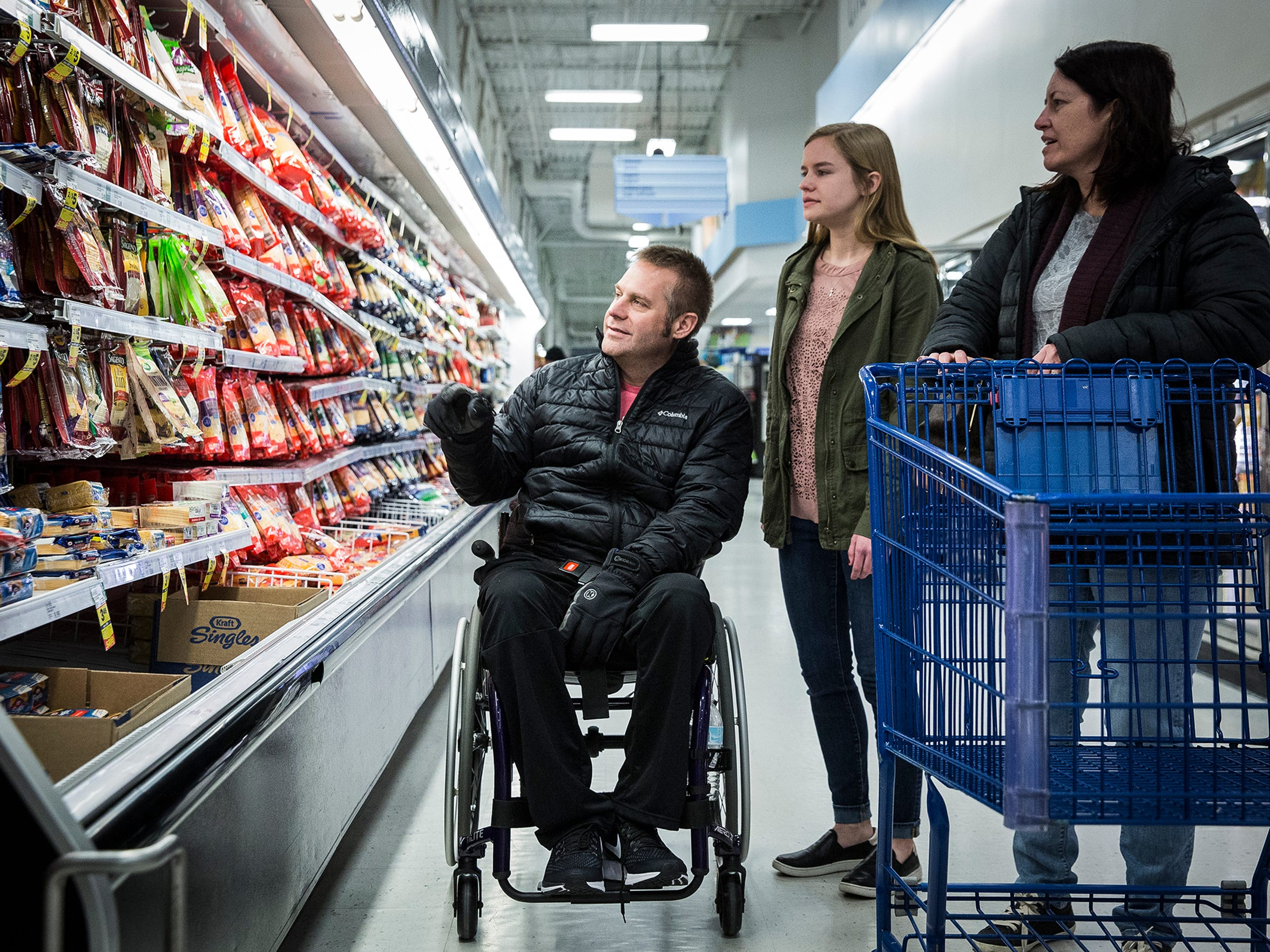 Jim, Angela and Ashley Wright make a grocery shopping