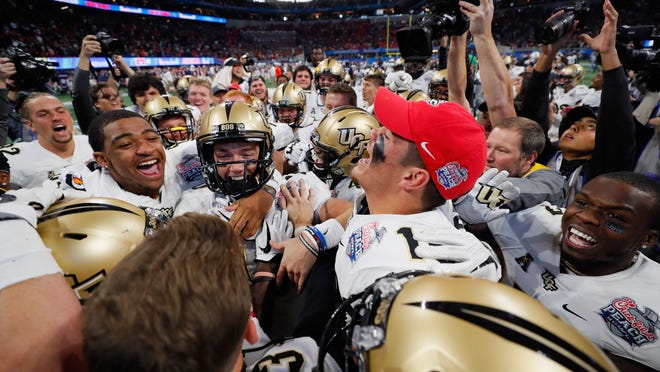 UCF celebrated a perfect season Monday after beating Auburn in the Peach Bowl.