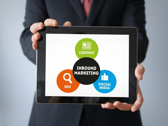 Man holding tablet showing the elements of inbound marketing