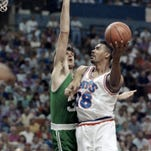 Cleveland Cavaliers forward John Williams (18) goes up for a shot against Kevin McHale of the Boston Celtics during a 122-104 NBA Eastern Conference semifinal win by Cleveland on May 18, 1992, in Richfield, Ohio. Williams, a popular sixth man with the Cavs from 1986 to 1995, has died.