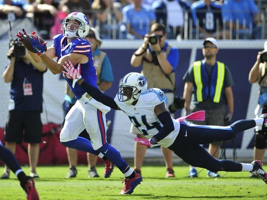 Titans cornerback Coty Sensabaugh fails to prevent Bills wide receiver Chris Hogan from making a 46-yard reception in the fourth quarter.